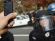 policeman being filmed on camera